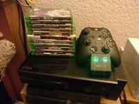 Boxed Xbox One with 11 games, 2 controllers, venom dual controller charging dock.