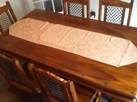 Solid sheesham wood table and six chairs.5.5 ft long 3 ft wide