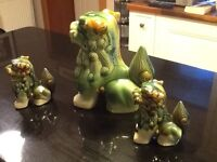 Chinese ornaments: 3 lovely Chinese Foo Dogs in mottled shades of green and earthen colors.