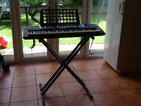 Yamaha keyboard YPT-210 with stand,adapter and book stand in excellent condition.