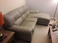 Pale grey leather corner sofa with matching foot stool