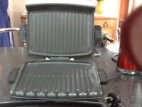 George Foreman Grill (lean grilling machine) with cookbook and assesseries