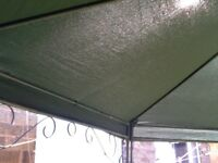 Gazebo thick good quality green Canvas top it is hextaganol in shape and is made of metal so strong