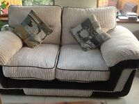 Fabric 2 seater seated, off white colour with brown leather trim