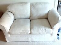 Laura Ashley 2 seater sofas . Cream Cost £700 each when new .Willing to sell separately £200 each