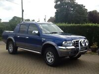 Blue and chrome Ford Ranger XLT Thunder pickup with rear locking roller shutter.