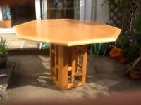 Hexagonal dining room table with additional extension leaf