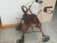 Mobility aide walker-lightly used ,in very good condition-has thick padded seat,lever brakes&basket