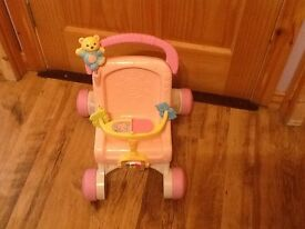 Pink baby pram walker