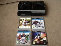 Sony PS3 80gb with dual shock controller and 4 games