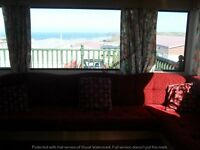 AMAZING SEA VIEWS AND LARGE ENCLOSED DECKING, TWO BEDROOM 6 / 7 BERTH VAN PERRANPORTH CORNWALL
