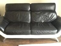 DFS leather sofa & chaise longue, good condition been kept in storage, black & white in colour,