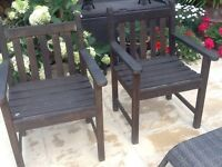 Two wooden chairs and bench with cushions
