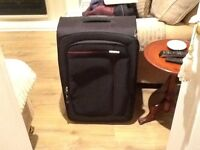Large near new light expandable suitcase
