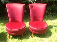 Two lovely red velvet chairs.