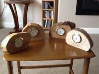 Natural shaped wooden surrounds with metal brass coloured watch battery type Clock inserts.