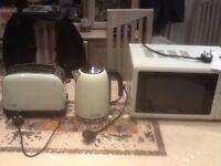 Jot lot- Russel Hobbs toaster(2slice)+Russel Hobbs cordless kettle+Goodmans 20 litre microwave oven