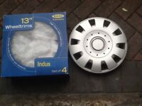"""2 sets of 13"""" car wheel trims.1 set still in box from new,the other used for 2weeks."""