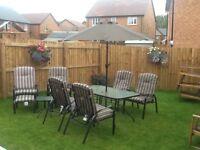 Eleven piece garden dining furniture