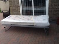Guest bed. Folds down to fit under standard single bed.