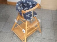 A 2 in 1 solid wood Highchair/table and chair with padded/cushioned seat cover no tools required