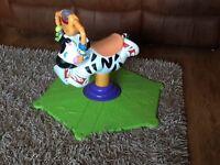 Zebra ride on bouncer