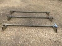 Roof bars for a medium height Ford Transit. Bars include little blue bag of fittings.