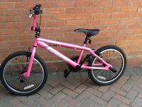 """20"""" Ammaco Booster girls pink BMX freestyle bike with stunt pegs and gyro brakes."""