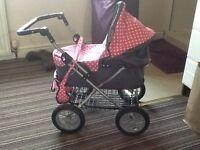 Girls pink polka dot pushchair