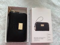 Genuine Brand new in Michael Kors black Python effect zip wallet -£35