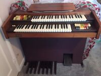 An organ for sale in Excellent condition 1 owner rarely used