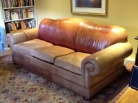 Three seater leather sofa bed. Approx H: 36 ins x D: 39 inches x W: 86 inches.