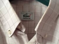 Lacoste genuine short sleeved shirt.