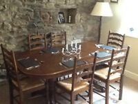 Magnificent extending oak dining table and six chairs -revised price