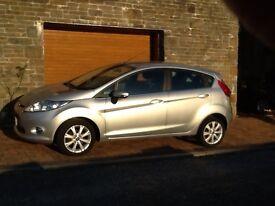 2011 Ford Fiesta 1200 Zetec 5 door. Silver, black interior. 27000 miles. A/C, E/W, E/M, alloys