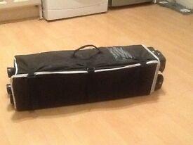Black sleep tight travel cot