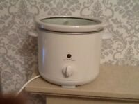 Small slow cooker in white.