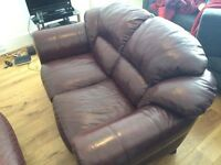 good condition red leather sofas.