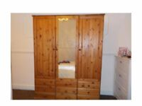 Double wardrobe with integral shelving unit and mirror. Plus drawers