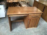 Pine desk in oak finish.