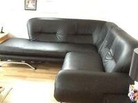Black leather corner settee