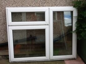 White PVC Double glazed window with two openings. Size 46 by 58 inches no damage