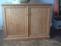 Sturdy pine cupboard with shelves and five sliding drawers