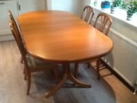 Teak oval extending dining table and 4 chairs