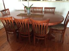 Oval timber table with pedestal legs and eight matching chairs Lilli Pilli Sutherland Area Preview