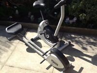 REEBOK EXERCISE BIKE and V-FIT ROWER.