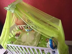 baby bed cot white woth curtains green and toy musical play on top