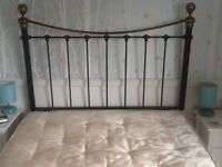 Headboard for 4ft 6inch bed. Black and brass effect metal.