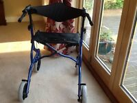 Four wheel mobility walker with seat. Blue. Good condition