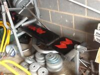 Weider gym bench with lots of different weights
